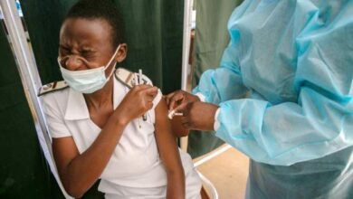 Photo of Zimbabwe asks state employees to take a jab or quit